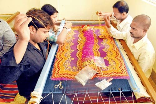 Dabka artists at work (Image Courtesy: Mid Day)