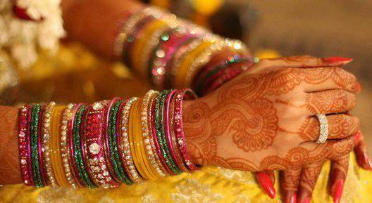 A bride wearing Glass Bangles