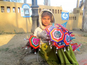 Kid glittering with Colorful Umbrellas designed by her Father