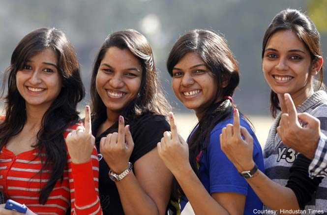 Young voters show off their marked fingers