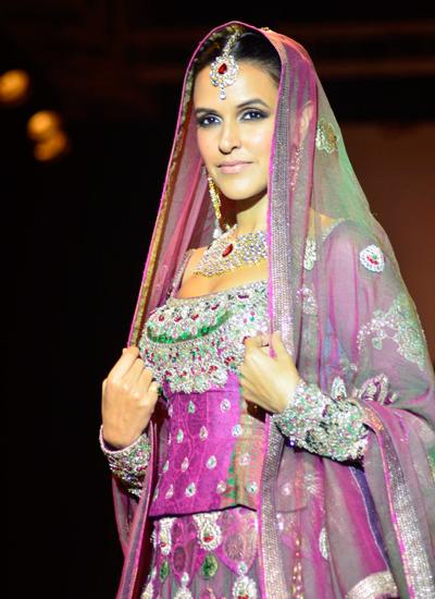 Neha Dhupia sporting Indian Bridal Attire