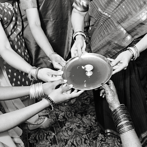 Women performing customs of Karwa Chauth together!