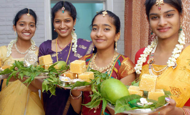 Girls participating in Ugadi celebrations with Bevu Balla (Neem and Jaggery) in their hands. (Image: http://archives.deccanchronicle.com)