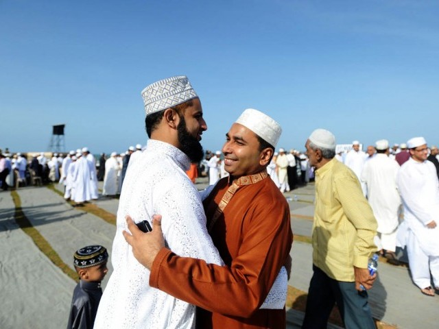 Men Greet Each Other After the Customary Morning Prayers (Image: http://tribune.com.pk)